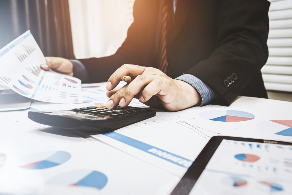 Certified public accountant correcting mistakes